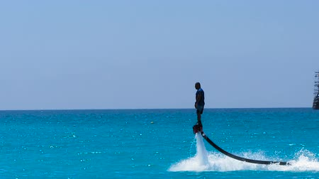 akció : Man flying on a board in the sea, active summer vacation with extreme sports