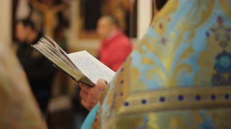 pastor : Orthodox Church clergyman reading psalm book, conducting festive service, prayer