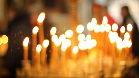 żyrandol : Many candles burning in church, bringing people peace and tranquility, prayer
