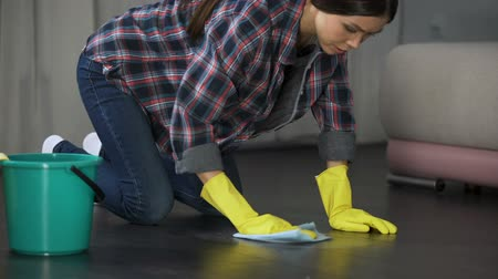 chemical agent : Woman upset with poorly polished floor and stains on wood parquet, cleaning Stock Footage