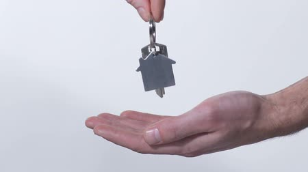 estate agency : Broker putting key from new house in buyers hand, purchase of real estate Stock Footage