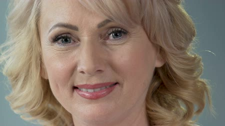 анти : Attractive female pensioner smiling and looking into camera, anti-age makeup