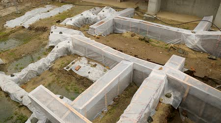on site research : Archeological excavations covered with plastic sheets, ruins protection, history