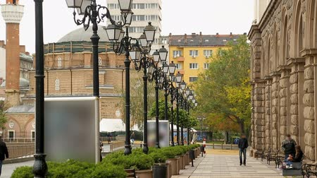 bolgár : Footpath aligned with streetlamps on one side in Sofia, Bulgaria, city look