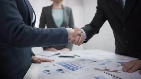 партнеры : Company representatives handshaking after contract sign, partnership symbol Стоковые видеозаписи