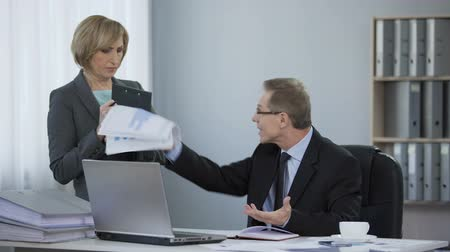 ethic : Tired boss angry at assistant, corporate ethics, inappropriate work behavior Stock Footage