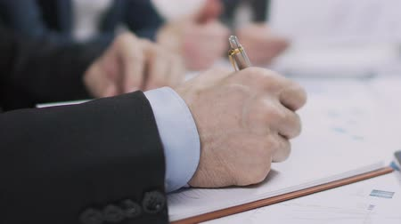 benefício : Male lawyer writing list of priorities in notebook, runup of election campaign Stock Footage