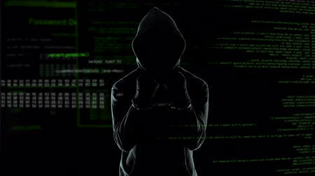 kajdanki : Dangerous male hacker in handcuffs looking into camera with anger, IT criminal
