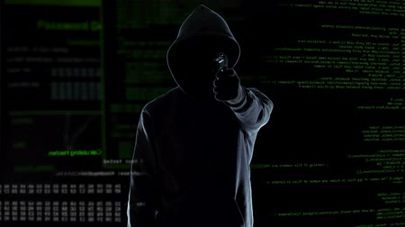 hírnév : Hacker silhouette holding gun, destroying security camera, threat and crime