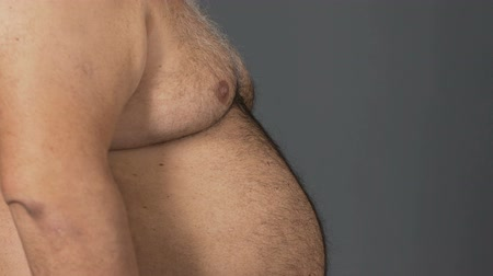 sports nutrition : Obese fat male with big belly on grey background, diet concept, health care