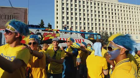 peppy : Active supporters jumping one after another near bus with Sweden soccer players