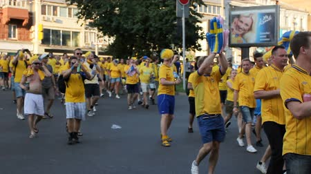 solidarność : Crowds of excited cheerful football fans walking along street showing solidarity