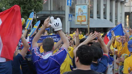 french team : French and Swedish national football team fans walking city during championship