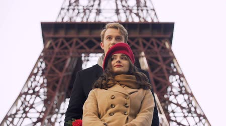 eiffel : Enamored guy coming on date to his beautiful girl with huge bouquet of roses Stock Footage