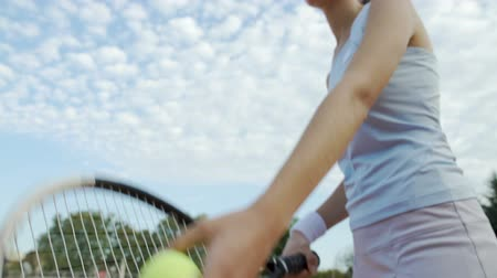 jogadores : Bottom view of beautiful woman serving tennis ball, professional sport, hobby