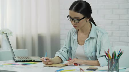 employed : Inspired designer creating project, freelancer enjoying work drawing with pencil Stock Footage