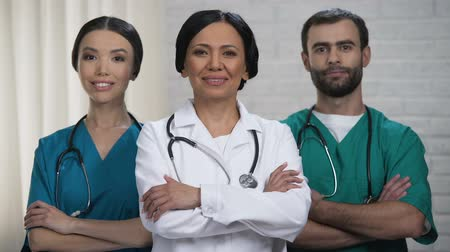 health insurance : Professional surgeon team ready for operation, patient treatment in safe hands Stock Footage