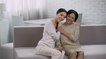 встреча : Asian women embracing, motherhood and grateful daughter, happy family meeting