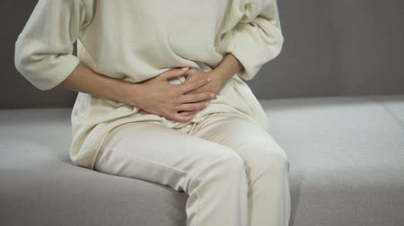 menstrual : Young woman suffering from strong menstrual or stomach ache, gynecology problems Stock Footage