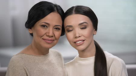понимание : Two women looking into camera, family love, healthy skin regardless of age Стоковые видеозаписи