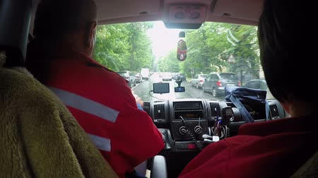 paramedics : Ambulance car rushing along narrow street to emergency call, view from cabin Stock Footage