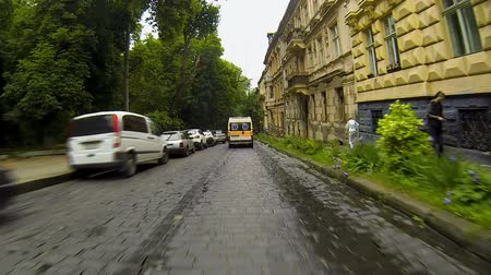 lviv : Ambulance driving on urgent call along narrow city streets, emergency response Stock Footage