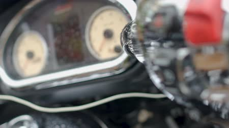 kavramak : Motorcycle speedometer and control panel with raindrops, trade show closeup