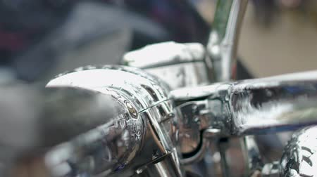 kavramak : Drops of rain falling down on motorcycle handlebars, transport trade show