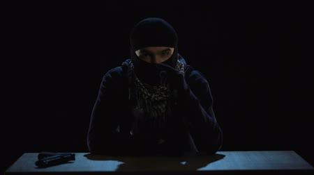 kidnapping : Terrorist writing video message with threats and warnings, global attack