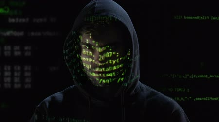 refletindo : Hacker scrutinizing inscription on monitor, holograms reflecting on face