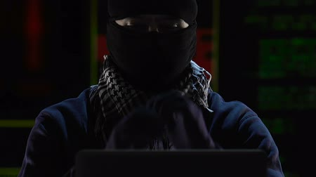 bomber : Islamist terrorist remotely controlling spread of cyber virus in banking systems Stock Footage