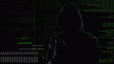 езда с недозволенной скоростью : Male hacker installed virus on enemy laptop, malicious software computer program