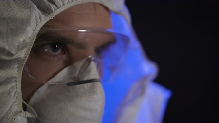 criminalist : Man wearing lab costume in clandestine laboratory, illegal drug producing Stock Footage