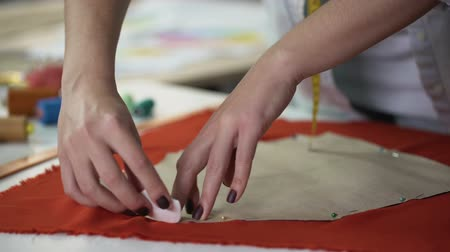 couturier : Stylist transferring template on textile pattern, process of clothes creation
