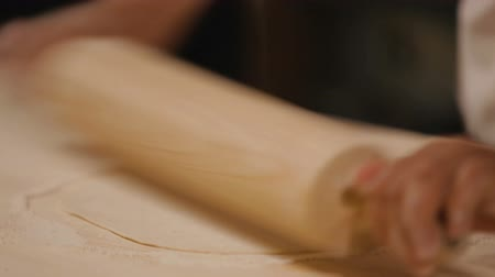 lavash : Experienced woman rolling dough with pin and putting it to bake, cooking lavash Stock Footage