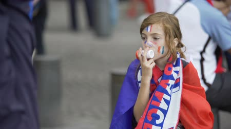 french team : Little girl blowing in tune to support national France football team, sound Stock Footage