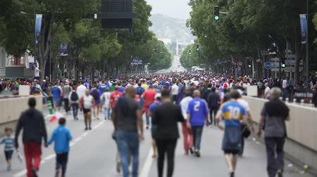 league : Crowd of fans walking along main street of Marseille, waiting match beginning Stock Footage