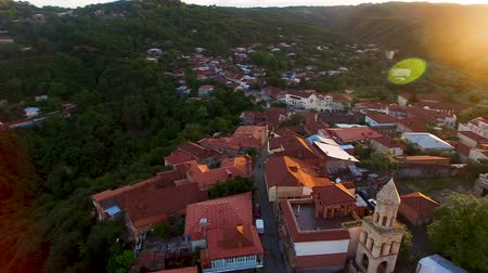 požehnání : Drone flying over the green hills and beautiful buildings in Sighnaghi at sunset