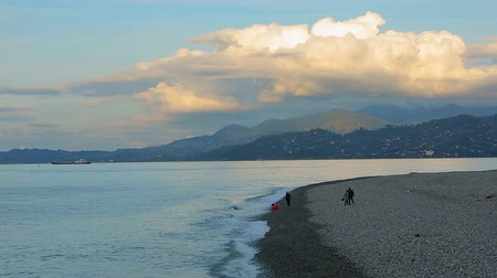subtropical : People walking along seashore in Batumi, Georgia, relaxing vacation atmosphere