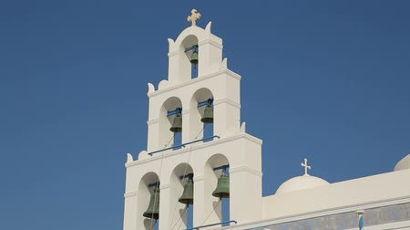 УВР : White Christian church with domes and bells standing against blue sky, sequence