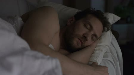 gaining : Adult bearded man sleeping in bed, exhausting day, sound sleep and night rest Stock Footage