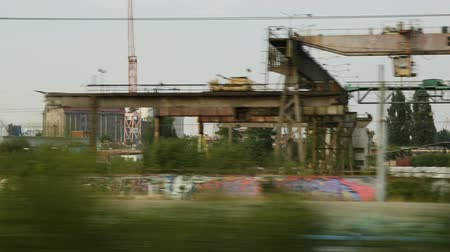 meio : Abandoned industrial area view from moving city train, post-soviet territory
