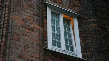 coming home : Half-opened window in old building, light coming out of it, private residence