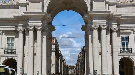 comercio : Lot of tourists coming to Lisbon to see famous Rua Augusta Arch, sequence