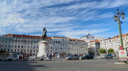 baixa : Tourists walking around Square of Fig Tree, looking at statue of King John