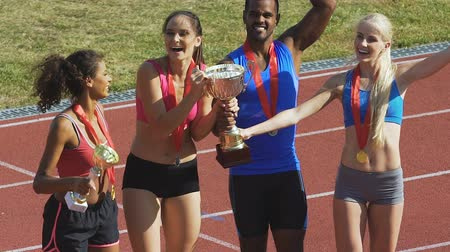 medal : Multiethnic team waving hands to supporters and fans, international competition Stock Footage