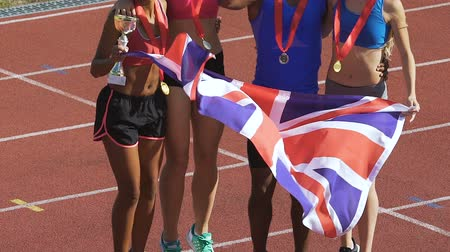 multiethnic : Athletes from England won trophies in sports competition, celebrating success Stock Footage