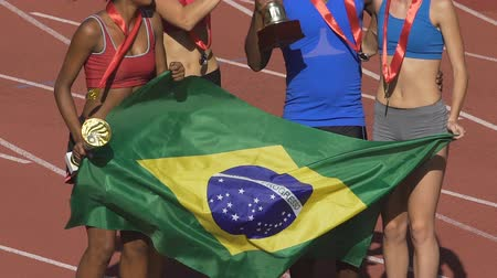 brazil : Brazilian sports team jumping and singing anthem of country, celebrating victory