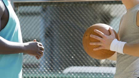 streetball : Two energetic men discussing basketball game strategy and rules at training Stock Footage