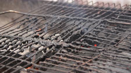heating up metal : Close-up of dirty old grill at open air poor eatery, unsanitary conditions Stock Footage